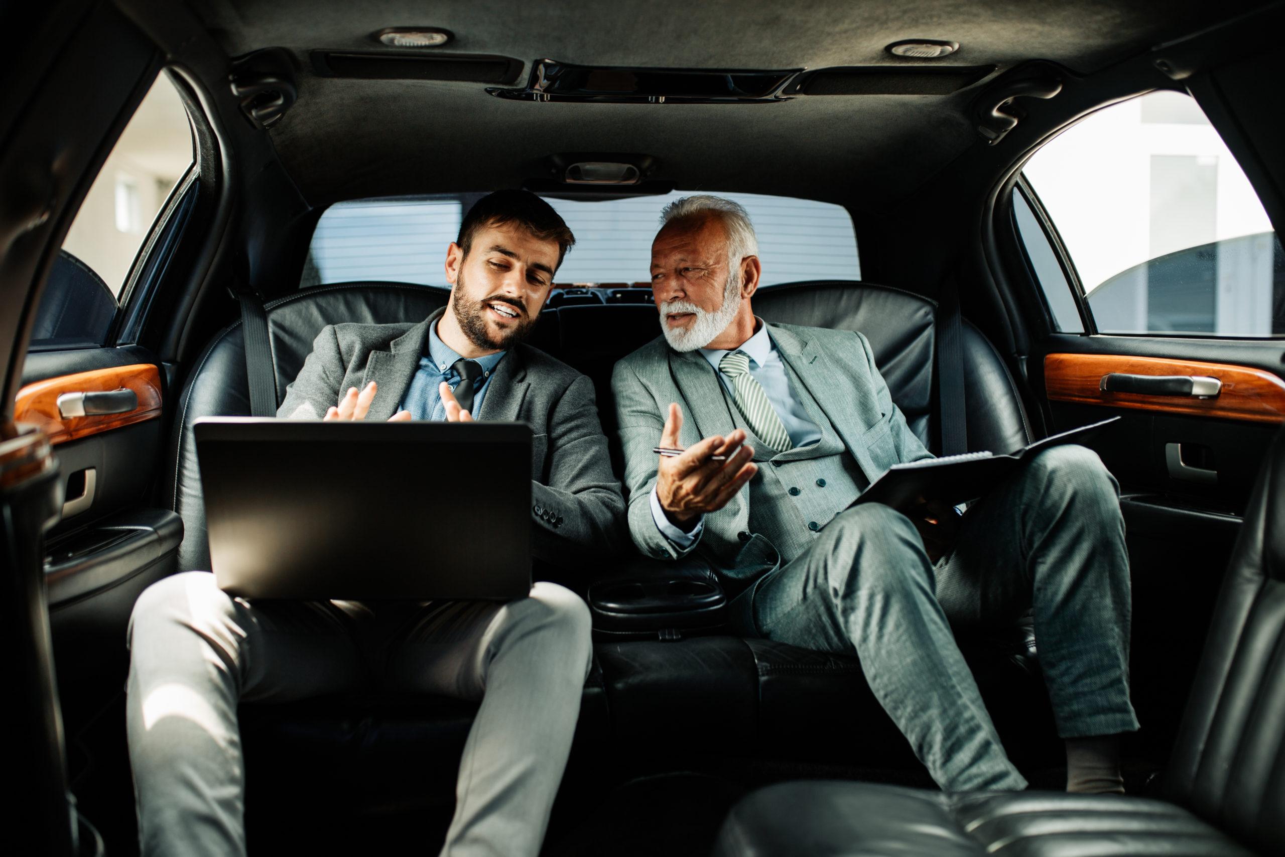2 man talk in a limousine