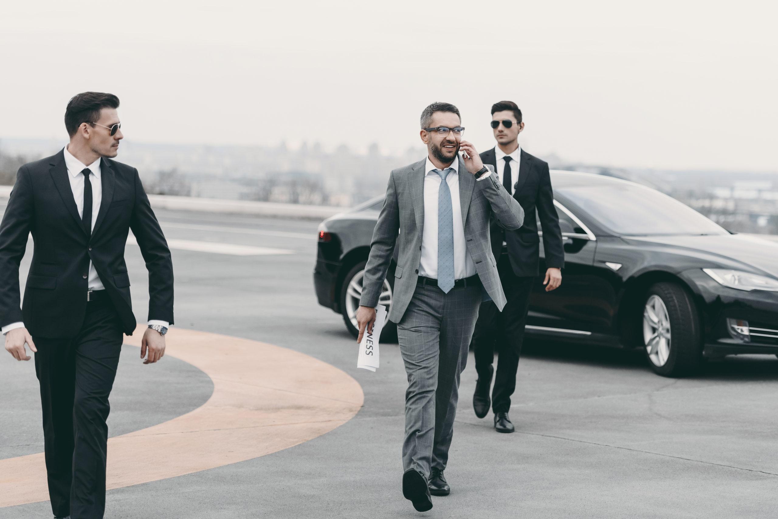 bodyguards on helipad